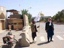 Taliban fighters keep watch in Ghazni province