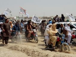 People on vehicles gather near Friendship Gate crossing on Pakistan-Afghanistan border, in Chaman